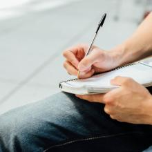 Man writing in notebook