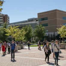 Students walking in front of Joseph F. Smith Building at BYU